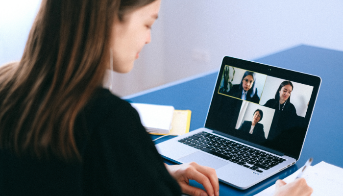 4 team members sitting on a video conference call