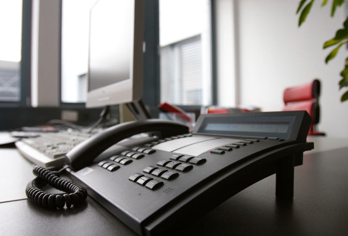 business phone sitting on desk
